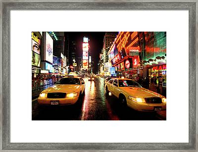 Yellow Crown Cabs Framed Print by Sean Davey