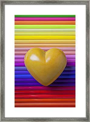 Yellow Heart On Row Of Colored Pencils Framed Print by Garry Gay