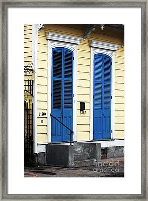 Yellow Row House In Orleans Framed Print by John Rizzuto