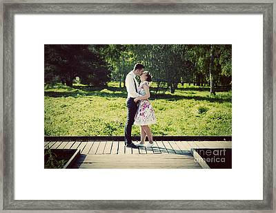 Young Couple In Love Standing On Wooden Cross-roads Framed Print by Michal Bednarek