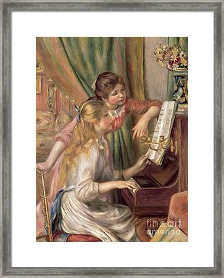 Young Girls At The Piano Framed Print by Pierre Auguste Renoir