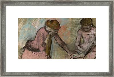Young Girls Looking At An Album Framed Print by Edgar Degas