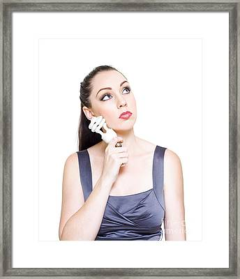 Young Modern Business Woman Holding Light Bulb Framed Print by Jorgo Photography - Wall Art Gallery