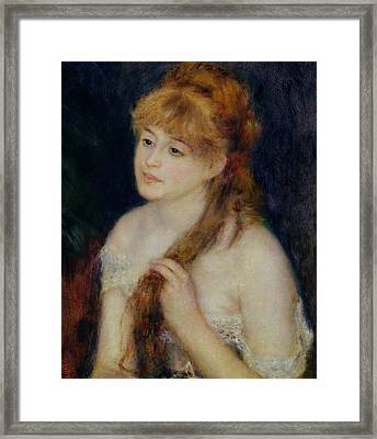 Young Woman Braiding Her Hair Framed Print by Pierre Auguste Renoir