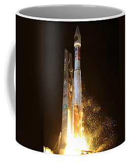 Coffee Mug featuring the photograph Atlas V Rocket Taking Off by Science Source