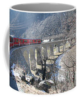Coffee Mug featuring the photograph Bernina Express In Winter by Travel Pics