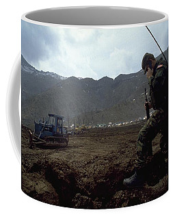 Coffee Mug featuring the photograph Boots On The Ground by Travel Pics