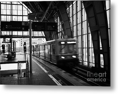 Berlin S-bahn Train Speeds Past Platform At Alexanderplatz Main Train Station Germany Metal Print by Joe Fox