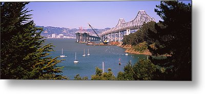 Cranes At A Bridge Construction Site Metal Print by Panoramic Images