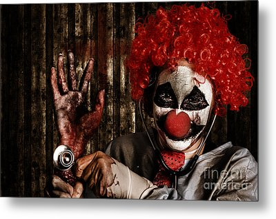 Frightening Clown Doctor Holding Amputated Hand  Metal Print by Jorgo Photography - Wall Art Gallery