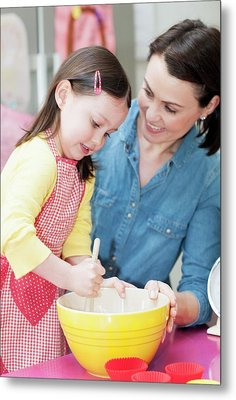 Mother And Daughter Baking Metal Print by Ian Hooton