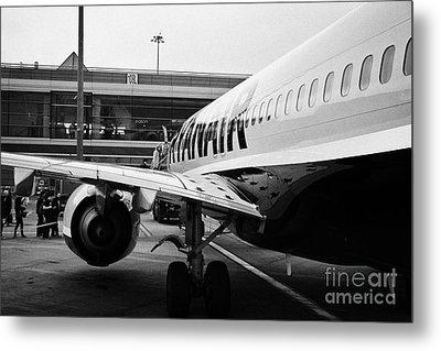 Passengers Boarding Ryanair Flight At Dublin Airport Terminal 1 Ireland Metal Print by Joe Fox
