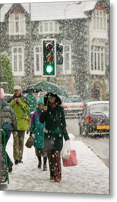 Shoppers Trudging Through Snow Metal Print by Ashley Cooper
