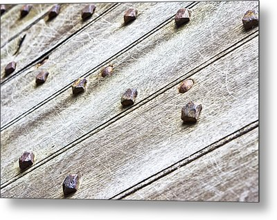 Studded Wooden Surface Metal Print by Tom Gowanlock
