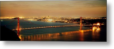 Suspension Bridge Lit Up At Dusk Metal Print by Panoramic Images