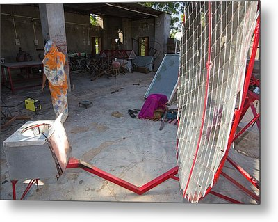 Women Constructing Solar Cookers Metal Print by Ashley Cooper