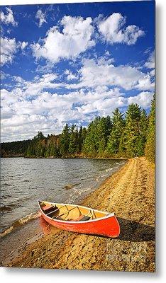 Red Canoe On Lake Shore Metal Print by Elena Elisseeva