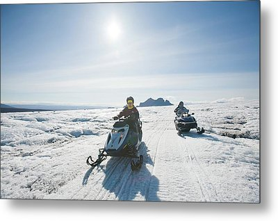Snowmobilers Metal Print by Ashley Cooper