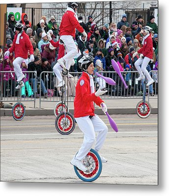 Unicyclists At A Parade Metal Print by Jim West