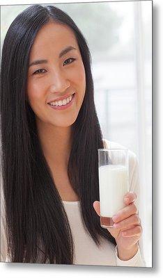 Woman Holding Glass Of Milk Metal Print by Ian Hooton