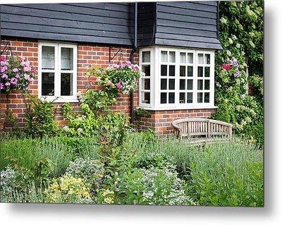 Cottage Garden Metal Print by Tom Gowanlock