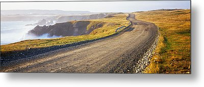 Dirt Road Passing Through A Landscape Metal Print by Panoramic Images