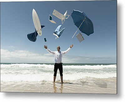 A Man Stands In The Ocean With Items Metal Print by Ben Welsh