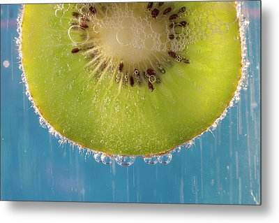 A Slice Of Kiwi Fruit In A Glass Metal Print by Brian Jannsen