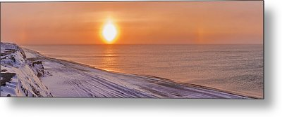 A Sundog Hangs In The Air Over The Metal Print by Kevin Smith