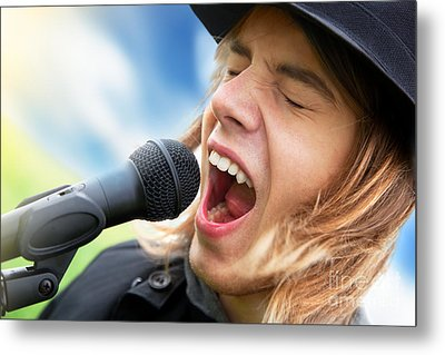 A Young Man Sings To A Microphone Metal Print by Michal Bednarek