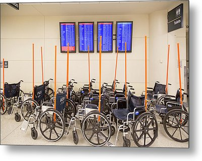 Airport Wheelchairs Metal Print by Jim West
