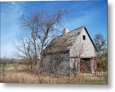 An Old Rundown Abandoned Wooden Barn Under A Blue Sky In Midwestern Illinois Usa Metal Print by Paul Velgos