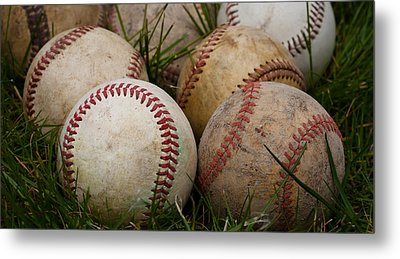 Baseballs On The Grass Metal Print by David Patterson