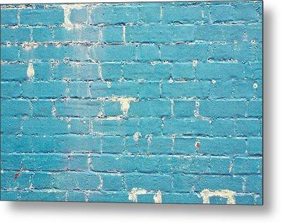 Blue Brick Wall Metal Print by Tom Gowanlock