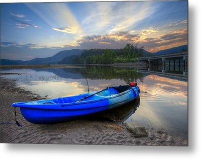 Blue Canoe At Sunset Metal Print by Debra and Dave Vanderlaan
