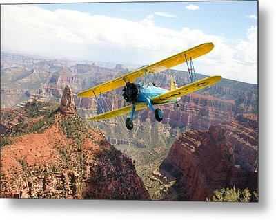 Boeing Stearman At Mount Hayden Grand Canyon Metal Print by Gary Eason