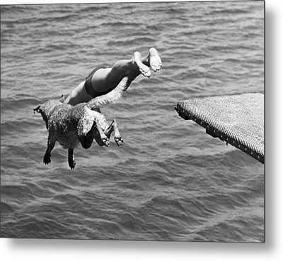 Boy And His Dog Dive Together Metal Print by Underwood Archives