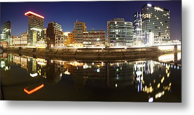 Buildings Lit Up At Dusk, Colorium Metal Print by Panoramic Images