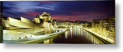 Buildings Lit Up At Dusk, Guggenheim Metal Print by Panoramic Images