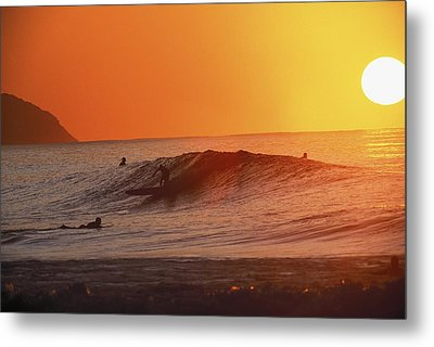 Catching A Wave At Sunset Metal Print by Vince Cavataio - Printscapes