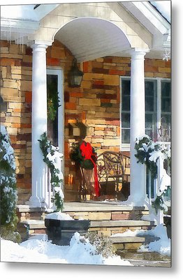 Christmas Sled On Porch Metal Print by Susan Savad