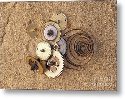 Clockwork Mechanism On The Sand Metal Print by Michal Boubin