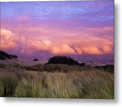 Clouds Catch Light From The Setting Sun Metal Print by Robert L. Potts