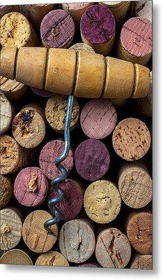 Corkscrew On Top Of Wine Corks Metal Print by Garry Gay