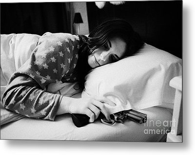 Early Twenties Woman With Hand On Handgun Under Pillow At Night In Bed In A Bedroom Metal Print by Joe Fox