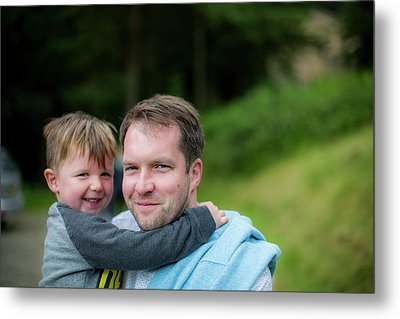 Father Holding Son Metal Print by Samuel Ashfield