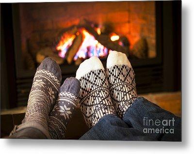 Feet Warming By Fireplace Metal Print by Elena Elisseeva