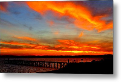 Fiery Skies And Silhouetted Pier Metal Print by Stephen Melcher