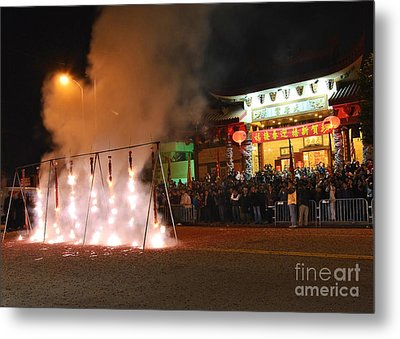 Firecrackers At Night During The Chinese New Years Celebration. Metal Print by Jamie Pham
