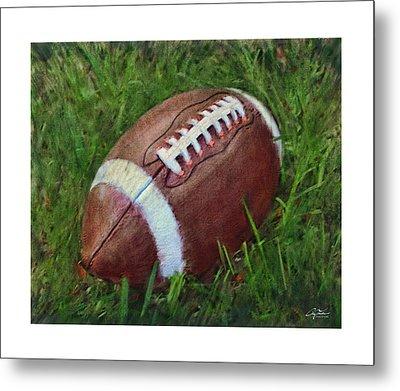 Football On Field Metal Print by Craig Tinder